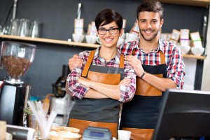 owner coffee shop smiling couple